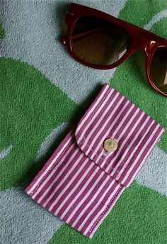 Here's a small and light coin purse made from the cuff of an old menswear shirt – it's just big enough to hold some cash and a driver's license. These are great for kids too – to hold ice cream money and beach or pool passes.