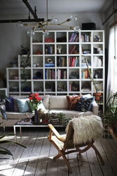 These bookshelves were built by the guy who lived in the loft before us. They're actually really oddly shaped and sized (some cubbies are de...