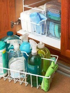 "Wire Storage Baskets ""Increase the storage capacity of kitchen cabinets by installing handy wire organizers. The shelves shown here are stackable, maximizing cleaning supply storage and ensuring cabinet contents are always within reach."""
