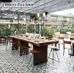 Encaustic cement tile (handmade designs pressed into cement) get mineral based elements for lasting color