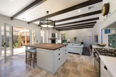 Mediterranean kitchen, timber benchtop to island bench, exposed beams, travertine flagstone flooring, handpainted cabinets Timber Benchtop, Flagstone Flooring, Mediterranean Kitchen, Island Bench, Exposed Beams, Travertine, Building Design, Cabinets, Interior Design