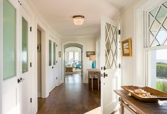 Double closets keeps this entryway organized and clean. I love the classic design on the door and windows.