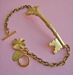 Your Luck Is In Key Bracelet - I wonder if this comes in silver...