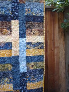 Jelly-roll quilt with batiks - I made this quilt for my Mother-in-Law