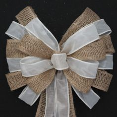 Since I can only have bows on the pews as decorations, this would match my theme.  Not sure how they'd look in the chapel though?  My mom can actually make bows like this if we get her the ribbon and burlap-just an FYI as well.  Burlap and Ivory Sheer Wedding Pew Bow by PackagePerfectBows, $10.99
