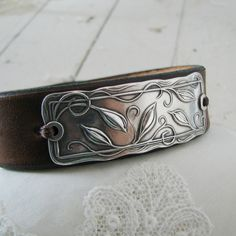 Everlasting, Handmade PMC Fine Silver Link with Leather Cuff Bracelet. $68.00, via Etsy.
