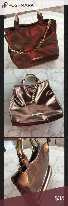 Shoulder bag, beautiful bronze tone. This bag is gently used, the color and the handles are beautifully combined (bronze &gold) goes great with any attire. Ivanka Trump Bags Shoulder Bags