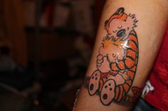 I love Calvin and Hobbes tattoos.