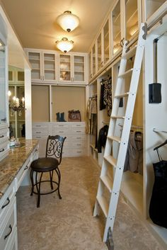 Library ladders are fun - yet they are funcational - to use the top of a walk in custom closet with a tall ceiling.   Innovate Home Org Columbus Ohio