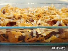 Frito Pie. 1.fritos  2.can of chili 3.cheese 4.bake till cheese is melted. 5.sour cream 6.FEED FACE!