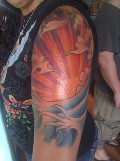 By Chris at Sleeping Giant Tattoo; San Diego, CA. Neotraditional Japanese, sunset, waves, clouds, arm, half sleeve.