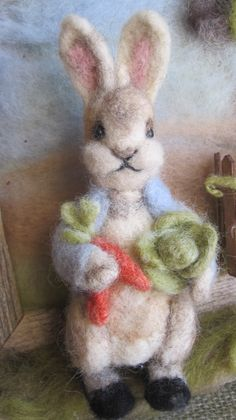 Peter Rabbit, a needle felted Peter Rabbit, sculpted out of wool.  Tutorial at www.naturecrafty.com