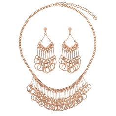 This 2-piece statement jewelry set flaunts linked circles and sophisticated details for an unexpected festive feel. Made of rose gold-tone brass. Necklace measures 17.5 inch with 3 inch extension in length with 1.5 inch in drop and secures with lobster claw clasp. Earrings measure 2.5 inch in length, 1 inch in width. Posts with butterfly back closures.