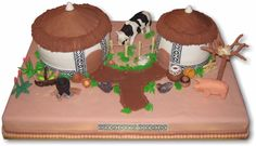 African Wedding Cake - Wedding cake made for a traditional African ceremony. Huts are vanilla cake covered with fondant. All animals and accessories are fondant.