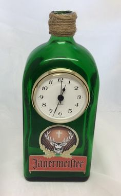 Jagermeister Bottle with Quartz Clock Bottle size: 22cm tall x 9cm wide x 6cm depthClock size: 6.5cm diameter (Dial pattern may vary)