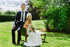 Bride & Groom Countryside portrait photography with chaise longue - Image by Nigel Edgecombe Photography - An intimate wedding with 10 guests at a weekend long break enjoying afternoon tea & three wedding cakes. Bride wears a backless lace wedding dress & groom in DKNY suit.