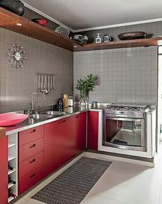 Red Kitchen Inspiration : Red lower cabinets, tiled gray walls and large upper shelf for storage and display