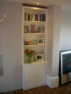 Trad alcove bookcase / cupboard option. Would do without the edging and the cupboard flush with walls