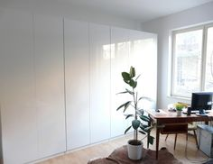 via Fat Cat Brussels [I must have a system of IKEA Pax high-gloss white wardrobes!]