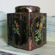 Decoupage and decorative painting on this tin box and some antique rust