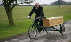 Any BODY want to buy this? UK's only tandem bicycle hearse up for sale... because priest fears it will damage his health