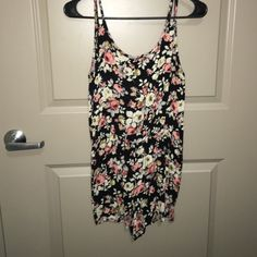 Floral Romper Only worn about 3 or 4 times! Just no longer fits me . Super cute with waistband and in very good condition! Poetry Dresses