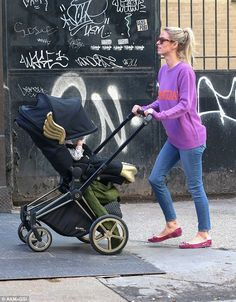 Expensive: Nicky Hilton took her new baby for a stroll around New York's Soho neighborhood in a $2,000 golden pram