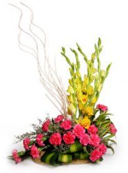 Pink Carnations and Yellow Gladioli in a Basket are arranged beautifully to look elegant.