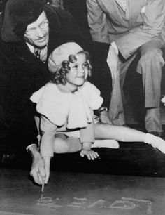 Six year old Shirley Temple was so young when she made her prints that cement artist Jean W.Klossner had to help her write her own name (1935)