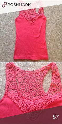 Coral Pink Crochet Tank Top Floral Style 101 Style 101 Coral Pink tank top. Crochet flower details. Size L/XL but fit like a medium. In very good condition. Please ask any questions  💲Open To Offers💲 🚫No Trades🚫 📦Ask About Bundle Discounts💰 style 101 Tops Tank Tops