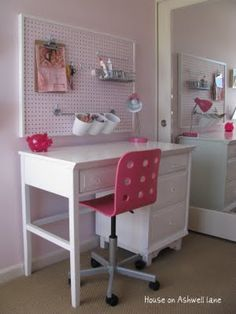 I'm doing something very similar to this for my daughter's craft area.  I love how she framed the pegboard and then hung it up with wire.  Only a one or two nail holes necessary!!!  I may have to do four of these in a quadrant so she can hang up her art.  Hmmmmm....