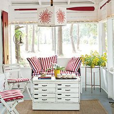 A red-and-white palette takes a modern turn with graphic prints such as the pendant lamp shade and the bold striped cushions with contrasting welts. | CoastalLiving.com