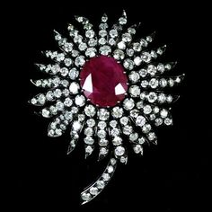 {Ruby and Diamond Flower Brooch set with 10.00 Carats of Ruby and 6.56 Carats of Diamond}{ht}