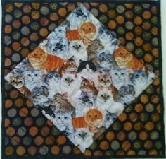 Middle of the table topper is an array of precious cats in different colors. colors of the cats. I have detailed stitched each corner using a decorative stitch in black cotton. I am sorry, but I do not know the designer of fabric I used. Cat Lover Gifts, Cat Gifts, Cat Quilt, Centerpieces, Table Decorations, Quilted Wall Hangings, Buy Fabric, Table Toppers, Gifts For Friends