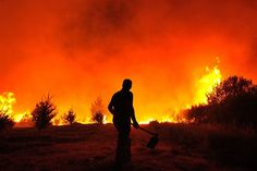 One of the more than a hundred fire fighters is shown fighting a fire that broke out early Saturday in the village of Nabais, Portugal, on Aug 21. The fire has destroyed several areas of bush and forest of the Serra da Estrela Natural Park
