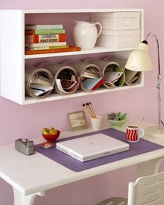 Paint Can Cubbies: don't let your desktop disappear under piles of paperwork. Inexpensive, unused cans can be purchased at paint stores; lined up on a shelf and anchored in place with Velcro, they become organizing cubbyholes with a modern flair.