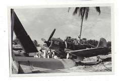 Corsair of VMF-155 undergoing maintenance, Aug 1944.