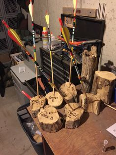 Cub Scout, Arrow of Light award. Embroidery floss to do the colors on the arrows was from Pinterest. I added the log sections for display.