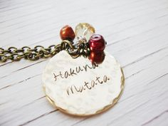 Hakuna Matata hand stamped brass necklace with by Lolasjewels