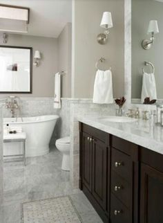 Marble gray and white bathroom with espresso cabinet