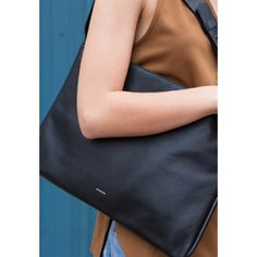 The Anesa shoulder bag is structured and sizable enough to carry a laptop but takes on a draped shape when toting smaller items. The zip closure opens to reveal two slip pockets, one zip pocket, a penholder and an earbud holder. Leather Accessories, Fashion Accessories, Skagen, Womens Purses, Leather Shoulder Bag, Purses And Bags, Fabric, Laptop, Closure
