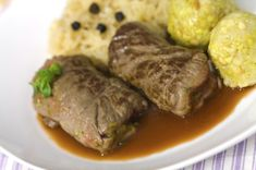German Beef Rouladen (beef rolls) is a popular German recipe for the holidays or festive dinners. Serve them with Spaetzle, mashed potatoes and red cabbage.