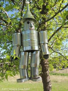 Make a tin man wind chime. You can find Wind chimes and more on our website.Make a tin man wind chime. Aluminum Can Crafts, Tin Can Crafts, Aluminum Cans, Metal Crafts, Diy And Crafts, Crafts With Tin Cans, Cork Crafts, Cardboard Crafts, Bottle Crafts
