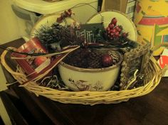 Gift basket for under $15!  Bowl, plates & basket from goodwill. Candles, picture frame, scented pinecones, ornament & decorations from craft store. Perfect thank you gift, Christmas gift or anytime gift. Quick, easy and affordable.