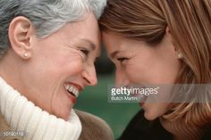 Stock Photo : Mature woman and adult daughter laughing, close-up