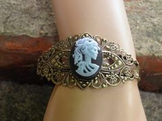 Hand Crafted Day of the Dead Bracelet Antiqued Bronze Filigree Black and Blue Gothic Lolita Skeleton Cuff by MelancholyMind, $14.99