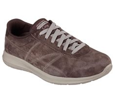 A classic sporty look combines with advanced comfort technology in the Skechers On the GO City shoe.  Soft pigskin suede and synthetic upper in a lace up sporty casual classic comfort sneaker with stitching and perforation accents.  Goga Mat insole.