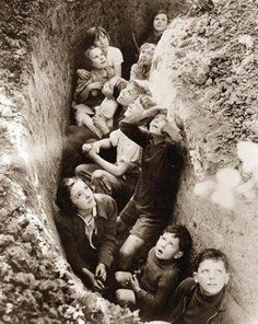 WW II children in a bomb shelter ditch