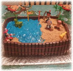 Jake and the Neverland Pirates cake. Easy to do. Use kit-Kat for outside and decorate 13x9 cake with toys and frosting.