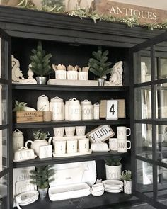 Love the white pieces in this  black hutch.